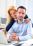 Portrait of Young attractive couple using laptop Stock Photos