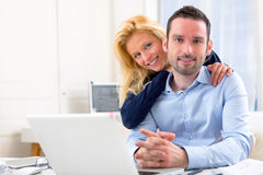 Portrait of Young attractive couple using laptop Stock Image