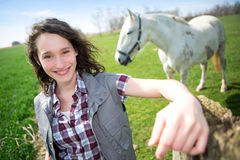 Portrait of a young attractive farmer in fields with horse Royalty Free Stock Photography