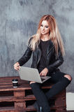 Portrait of young attractive freelancer girl using her laptop computer to send messages and searching information on internet. Portrait of young attractive stock photography