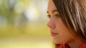 Portrait of Young Attractive Girl in a Knit Scarf in the Autumn Forest, Side View. Beautiful Woman stock footage