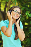 Portrait of young attractive girl listening to music with headph. Ones Stock Image
