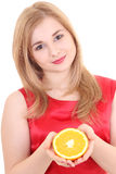 Portrait of young attractive girl with orange over white Stock Photography