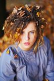 Portrait of young attractive girl with yellow leaves in her hair on autumn background. Portrait of young attractive girl with yellow leaves in her hair on Stock Image
