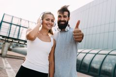 Portrait of young attractive happy fitness couple. Together outside stock photography