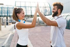 Portrait of young attractive happy fitness couple. Together outside stock images