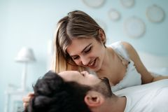 Portrait of young loving couple in bedroom Stock Photos