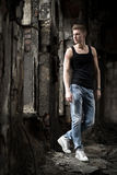 Portrait of young attractive man on abandoned background Royalty Free Stock Photos