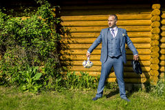 Portrait of young and attractive man in grey blue suit. Stock Photo