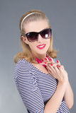 Portrait of young attractive pinup girl in sunglasses Royalty Free Stock Images