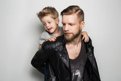 Portrait of young attractive smiling father playing with his little cute son. Fathers day Royalty Free Stock Photos