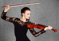 Portrait of a young attractive violinist woman in a black evenin Stock Photo