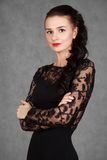 Portrait of a young attractive woman in a black evening dress Royalty Free Stock Image