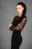 Portrait of a young attractive woman in a black evening dress Royalty Free Stock Photo