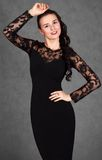 Portrait of a young attractive woman in a black evening dress Royalty Free Stock Images
