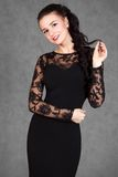 Portrait of a young attractive woman in a black evening dress Royalty Free Stock Photos