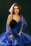 Portrait of young attractive woman in blue dress Royalty Free Stock Photos
