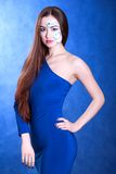 Portrait of a young attractive woman with a blue face art Royalty Free Stock Photo