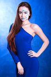 Portrait of a young attractive woman with a blue face art Royalty Free Stock Photos