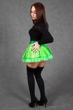 Portrait of a young attractive woman in a bright green skirt Royalty Free Stock Image