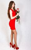 Portrait of a young attractive woman with a bunch of roses Royalty Free Stock Photography