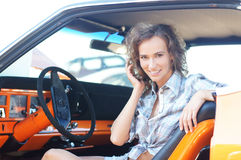 Portrait of a young and attractive woman in a car Stock Photo