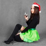 Portrait of a young attractive woman in a Christmas hat with a g Stock Photo