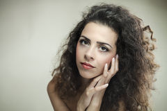 Portrait of a young attractive woman with curly hair Royalty Free Stock Images