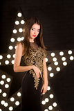 Portrait of young attractive woman, fashion. Star background royalty free stock photos