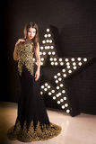 Portrait of young attractive woman, fashion. Star background stock image