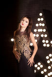 Portrait of young attractive woman, fashion. Star background stock images