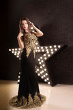 Portrait of young attractive woman, fashion. Star background royalty free stock images