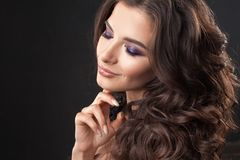 Portrait of a young attractive woman with gorgeous curly hair. Attractive brunette royalty free stock photography