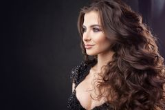 Portrait of a young attractive woman with gorgeous curly hair. Attractive brunette. Close up stock photography