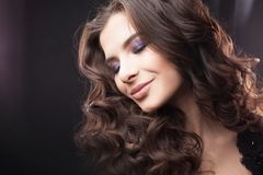 Portrait of a young attractive woman with gorgeous curly hair. Attractive brunette. Close up stock photo