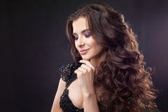 Portrait of a young attractive woman with gorgeous curly hair. Attractive brunette. Close up stock photos