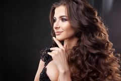 Portrait of a young attractive woman with gorgeous curly hair. Attractive brunette. Close up royalty free stock images
