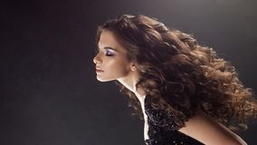 Portrait of a young attractive woman with gorgeous curly hair. Attractive brunette royalty free stock photos
