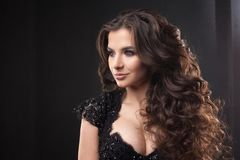 Portrait of a young attractive woman with gorgeous curly hair. Attractive brunette. royalty free stock photos
