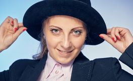 Young attractive woman in a hat. Portrait of a young attractive woman in a hat Royalty Free Stock Photography