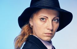 Young attractive woman in a hat. Portrait of a young attractive woman in a hat Royalty Free Stock Images