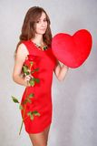 Portrait of a young attractive woman with a heart-shaped pillow Royalty Free Stock Images