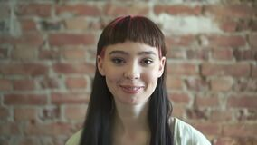 Portrait of a young attractive young woman with hipster hairstyle. spbd. modern appearance of woman