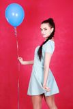 Portrait of a young attractive woman holding blue balloon Stock Image