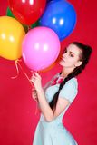 Portrait of a young attractive woman holding bunch of many brigh Royalty Free Stock Images