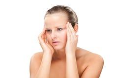 Woman massaging pain head Stock Image