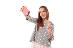 Portrait of a young attractive woman making selfie photo on smar Royalty Free Stock Photography
