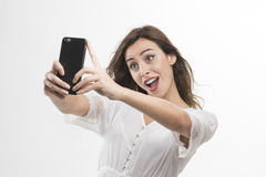 Portrait of a young attractive woman making selfie photo on smartphone Royalty Free Stock Photo