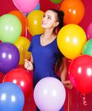 Portrait of a young attractive woman among many bright balloons Royalty Free Stock Images