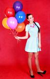 Portrait of a young attractive woman with many bright balloons Royalty Free Stock Photo